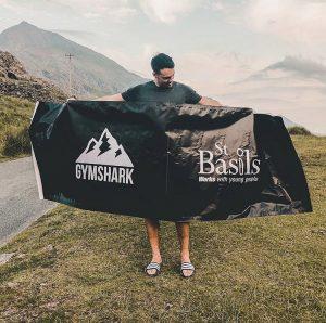 Gymshark hold up St Basils banner
