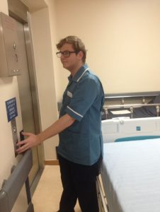 Chris at work as a health care assistant